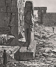 artist admiring Colossus at Karnak
